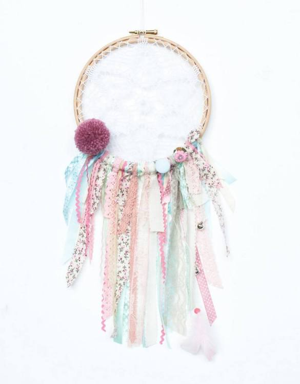 Perfect for a nursery or child's bedroom, the Roses Handmade Dream Catcher looks great as a new baby gift or to hang in the baby's nursery. Dream catchers are totems that represent good energy, and neutralize negative energy at home.