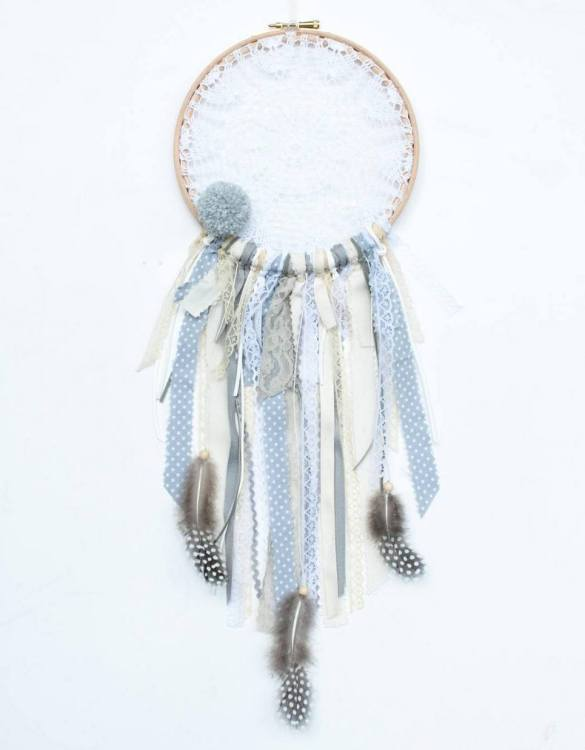 Perfect for a nursery or child's bedroom, the Winter Morning Handmade Dream Catcher looks great as a new baby gift or to hang in the baby's nursery. Dream catchers are totems that represent good energy, and neutralize negative energy at home.
