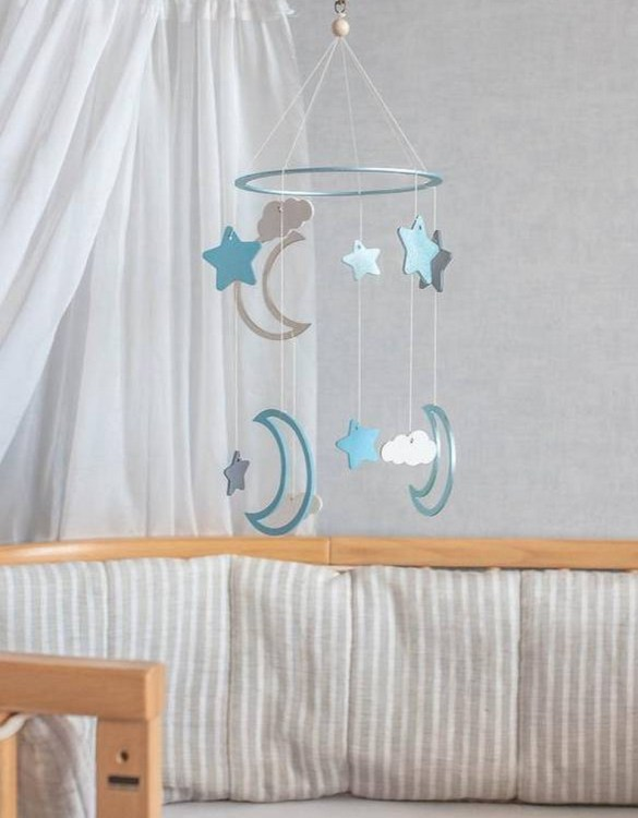A perfect addition to any baby's room, the Moon and Stars Blue Wooden Baby Mobile enchants children's eyes and escorts them into the land of dreams. This enchanting neutral gender baby mobile is sure to delight any child and will make the cutest addition to a woodland themed nursery decor.