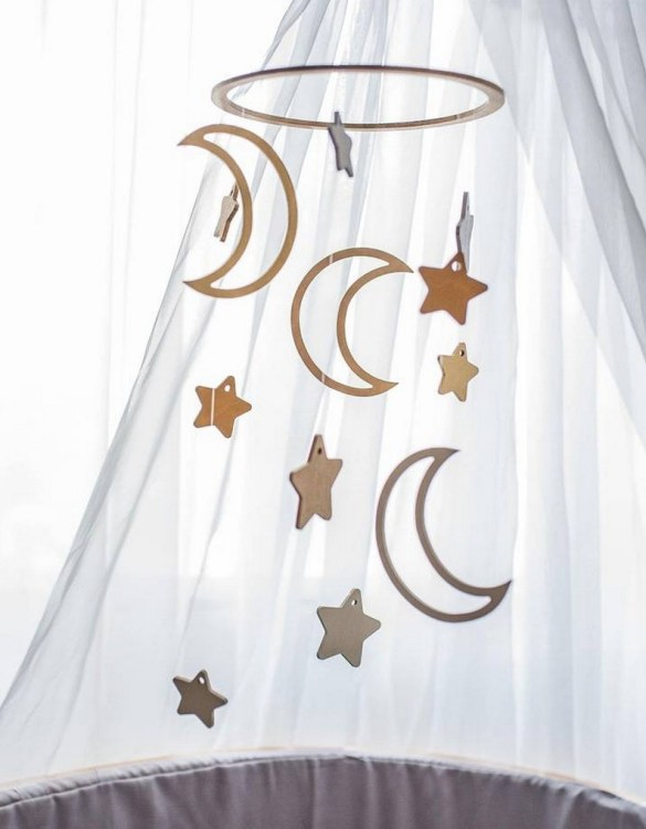 A perfect addition to any baby's room, the Moon and Stars Wooden Baby Mobile enchants children's eyes and escorts them into the land of dreams. This enchanting neutral gender baby mobile is sure to delight any child and will make the cutest addition to a woodland themed nursery decor.