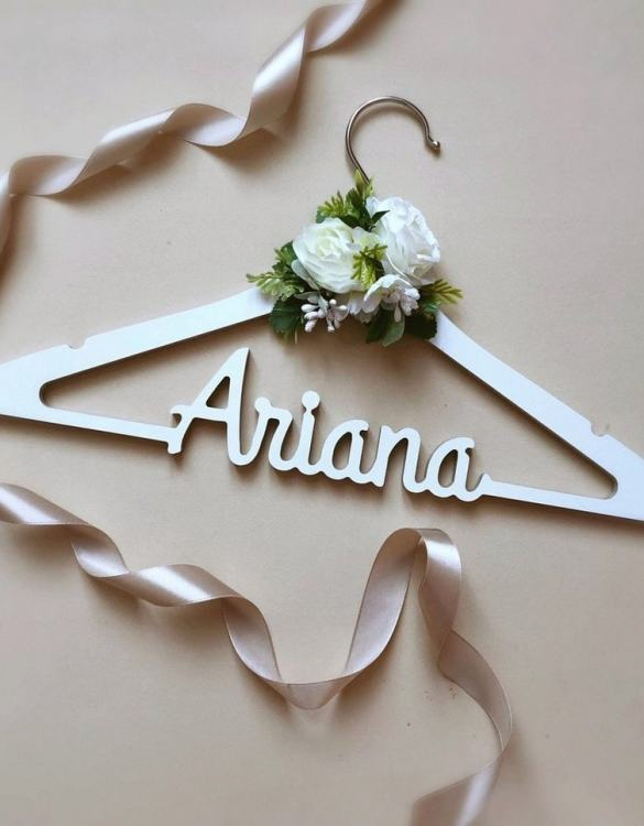 A beautiful way to display tiny clothes and make a wonderful keepsake, the Personalised Wedding Dress Hanger is a lovely little extra for your baby's clothes. A wonderfully unique children's clothes hanger, it is perfect for hanging up their favourite outfit or simply as a wall decoration in their own right.