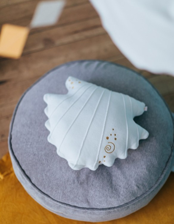 Ready for bedtime cuddles, the Sea Shell Children's Cushion makes a thoughtful gift, sending a great big hug when your arms won't reach.