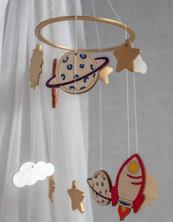 A perfect addition to any baby's room, the Space Theme Wooden Baby Mobile enchants children's eyes and escorts them into the land of dreams. This enchanting neutral gender baby mobile is sure to delight any child and will make the cutest addition to a woodland themed nursery decor.