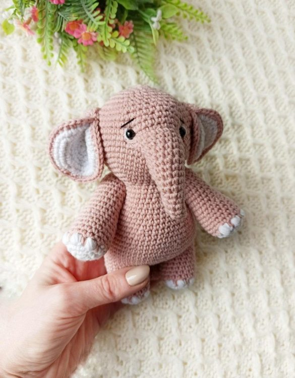 Strong and courageous, the Hand Knitted Elephant Children's Plush Toy will watch over your little one each night and be by their side through every adventure. A friend for life.