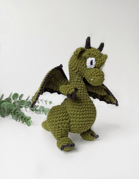 Strong and courageous, the Hand Knitted Green Dragon Children's Plush Toy will watch over your little one each night and be by their side through every adventure. A friend for life.