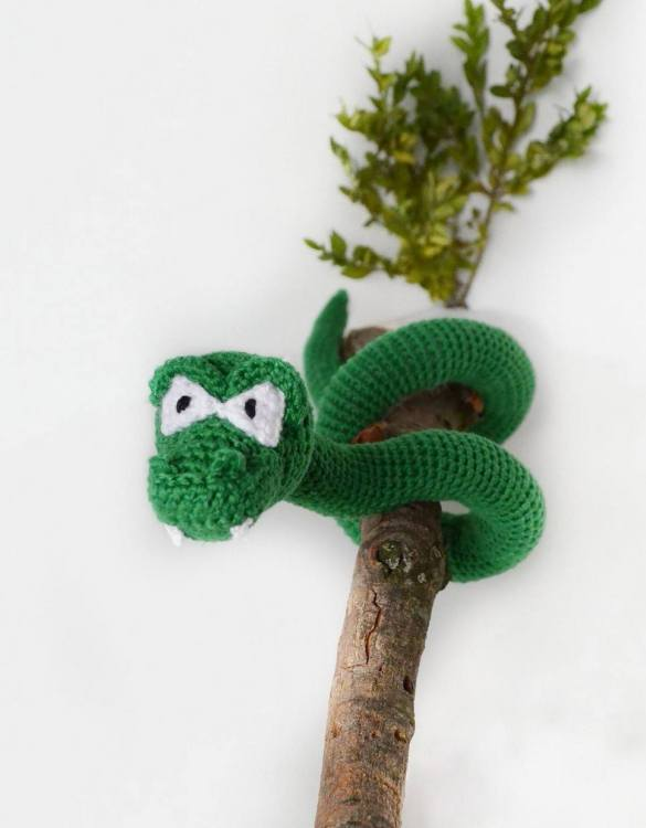 Strong and courageous, the Hand Knitted Snake Children's Plush Toy will watch over your little one each night and be by their side through every adventure. A friend for life.