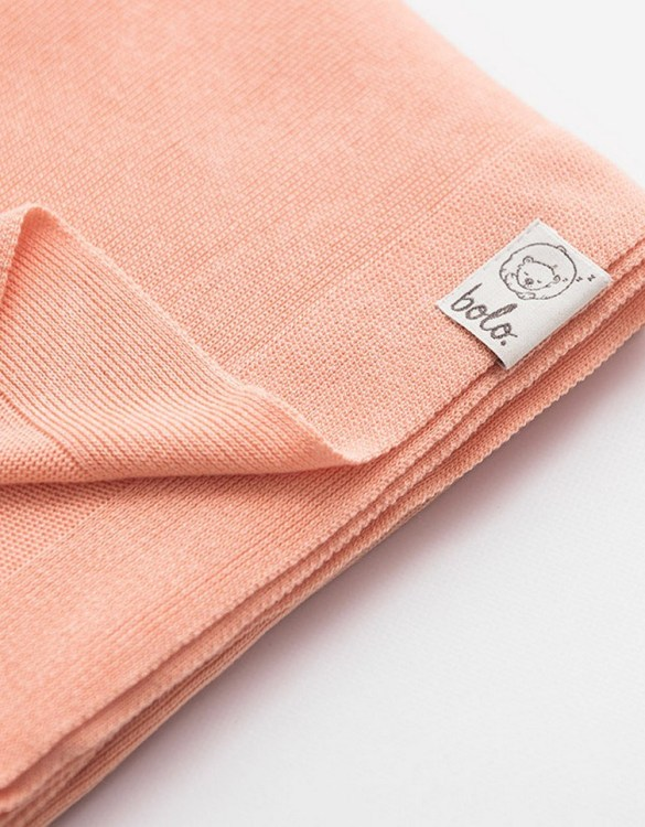 Chic and cozy, the Peach Light Baby Bamboo Blanket adds a playful touch that will catch your little one's attention. The super soft material of this hooded baby blanket, feels almost like felt and is perfect for wrapping a new bundle of joy up in and is the perfect way of welcoming a new baby home.
