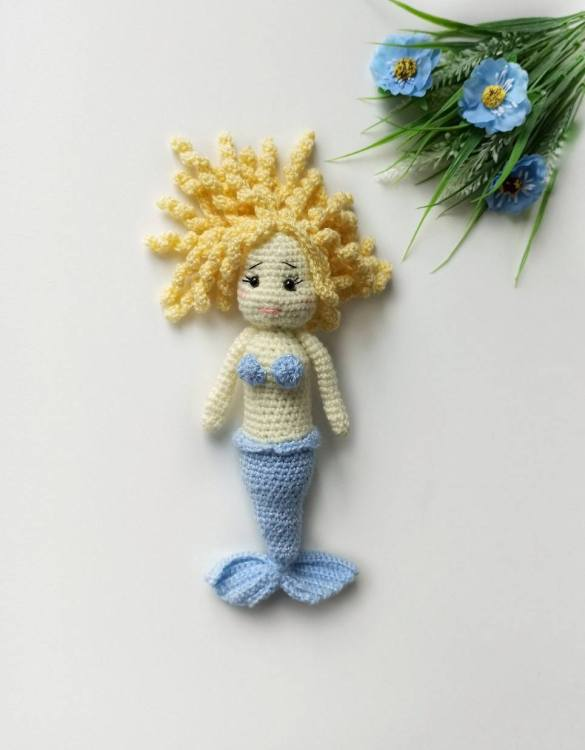 Strong and courageous, the Baby Girl Mermaid Doll will watch over your little one each night and be by their side through every adventure. A friend for life.