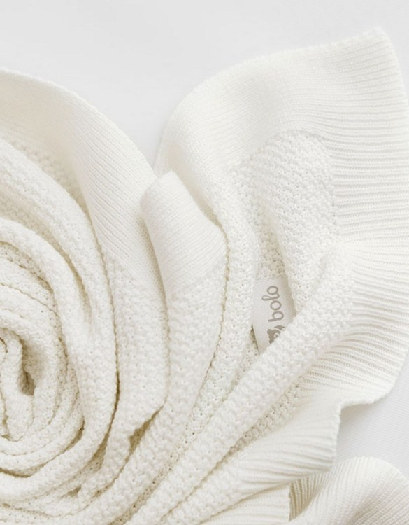 Chic and cozy, the Ecru Baby Cotton Blanket adds a playful touch that will catch your little one's attention. The super soft material of this hooded baby blanket, feels almost like felt and is perfect for wrapping a new bundle of joy up in and is the perfect way of welcoming a new baby home.