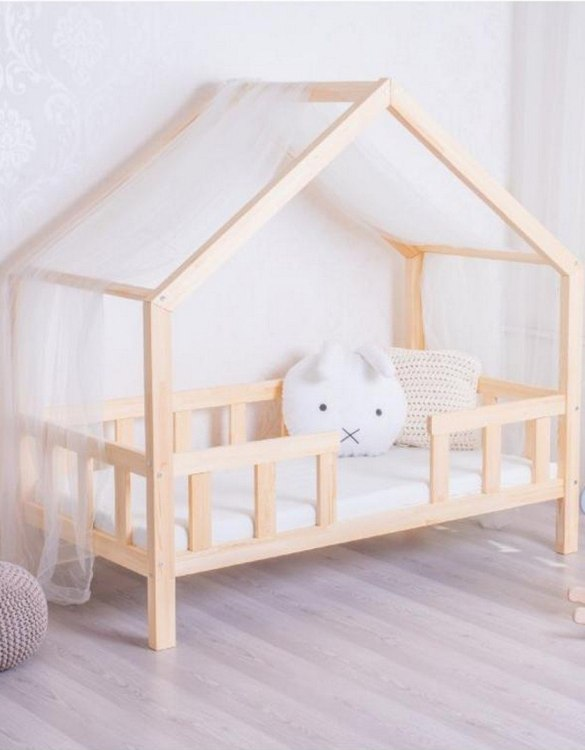 Turn bedtime into a magical adventure with the Hausbett House Bed with Safety Barriers. An amazing Montessori bed for children where they can sleep and play.