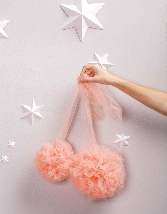 A simple yet effective way to transform your nursery, the Light Coral Soft Tulle Pom Poms is sure to capture your little one's attention! Whether you hang on your Christmas tree, in a nursery or down your table as a centrepiece, these soft tulle pom poms are perfect for adding some fluffy love to your space.