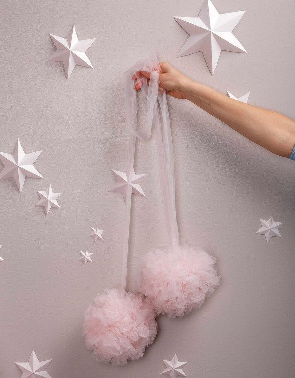 A simple yet effective way to transform your nursery, the Light Rose Soft Tulle Pom Poms is sure to capture your little one's attention! Whether you hang on your Christmas tree, in a nursery or down your table as a centrepiece, these soft tulle pom poms are perfect for adding some fluffy love to your space.