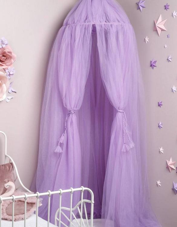 A magical space with whimsical charm, the Lilac Tulle Bed Canopy is a perfect accent for the nursery room. Turn bedtime into a magical adventure with this charming children's bed canopy. An amazing place for children where they can sleep and play.