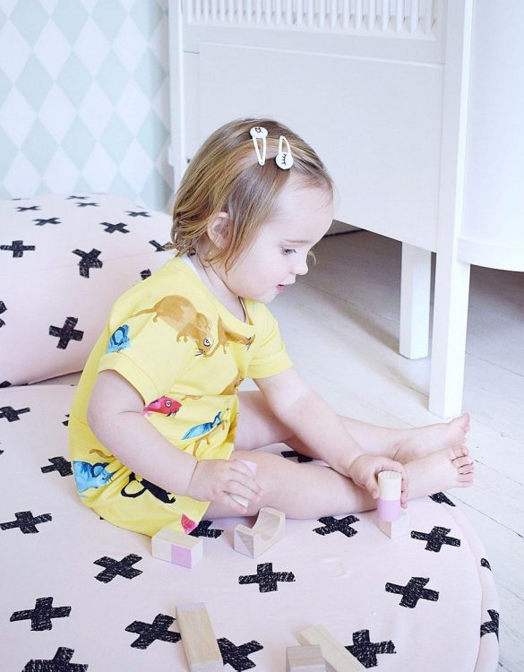 Perfect for tummy time for newborns and babies, the Pluses on Powder Pink Baby Play Mat will make a lovely addition to any nursery as a decorative rug, or as a play mat in a nursery or playroom.