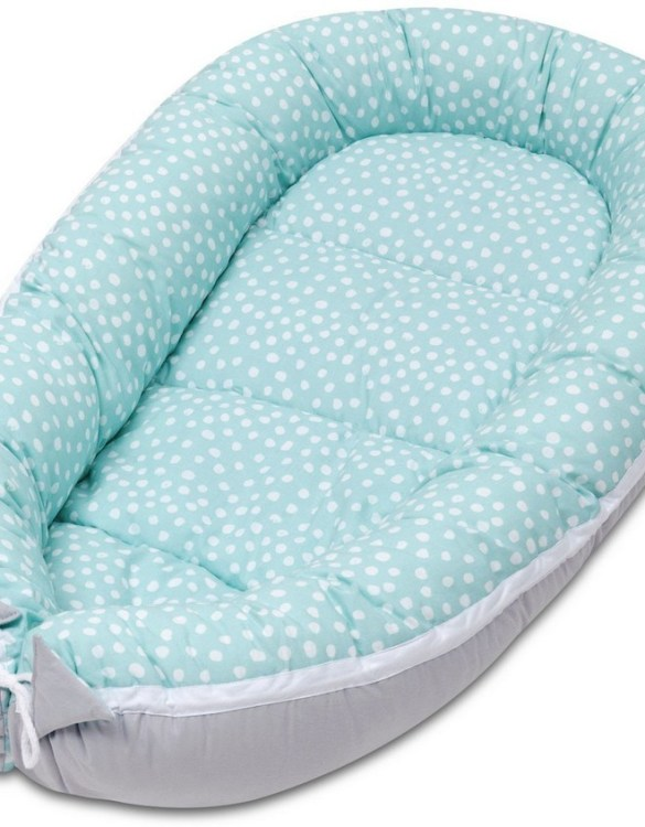 With a stylish design, the Mint Dotty Baby Nest Cocoon ensures that your baby sleeps in a cosy and soft environment, which is the best idea when a crib is still very big within the first few months.