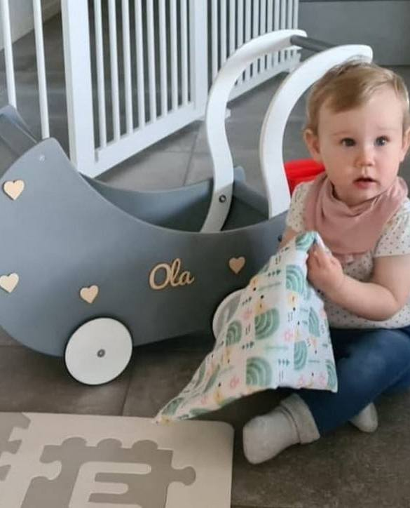 Allows you to carry dolls and teddy bears, the Dark Grey with Hearts Personalised Wooden Doll Pram helps to learn to walk and improves acquired walking skills. A gorgeous toddler wooden doll pram made from wood with an option of adding your child's name and including bedding set: duvet, pillow and bedsheet.