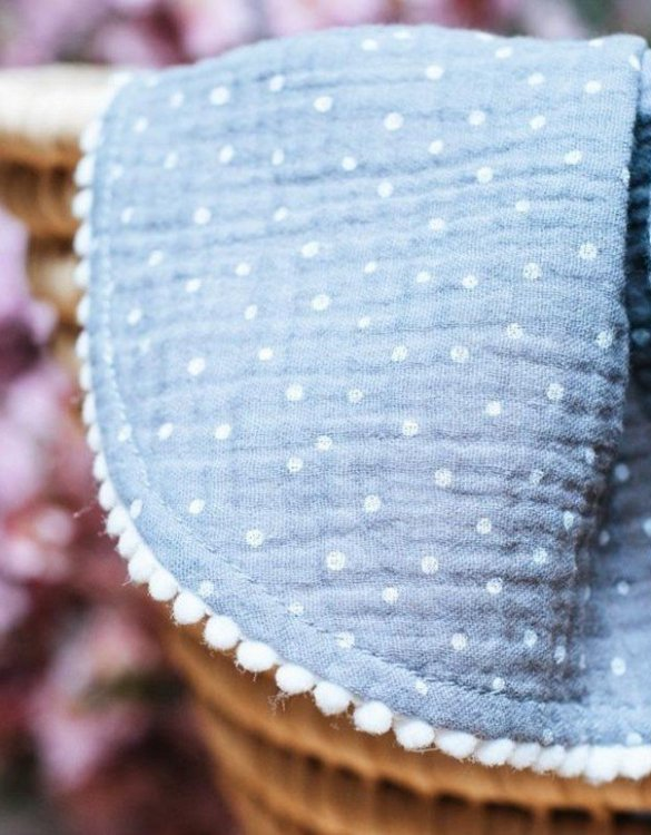 Treat your little one to cosy comfort, the Grey Polka Dot Pompon Blanket will keep baby feeling secure and warm, perfect for keeping your baby comfortable when you're out and about. A tender wrap makes your baby feel safe and secure in the big, new world.