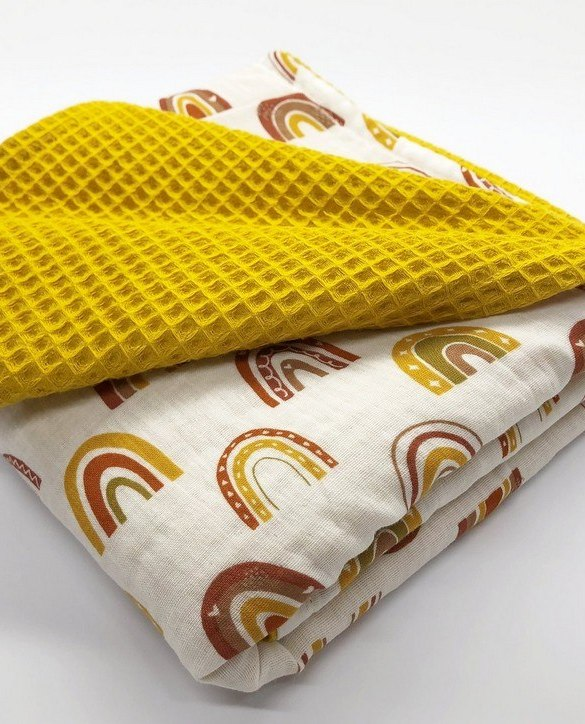 Treat your little one to cosy comfort, the Ocher Rainbow Waffle Blanket will keep baby feeling secure and warm, perfect for keeping your baby comfortable when you're out and about. A tender wrap makes your baby feel safe and secure in the big, new world.