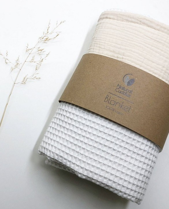 Treat your little one to cosy comfort, the White - Beige Waffle Blanket will keep baby feeling secure and warm, perfect for keeping your baby comfortable when you're out and about. A tender wrap makes your baby feel safe and secure in the big, new world.