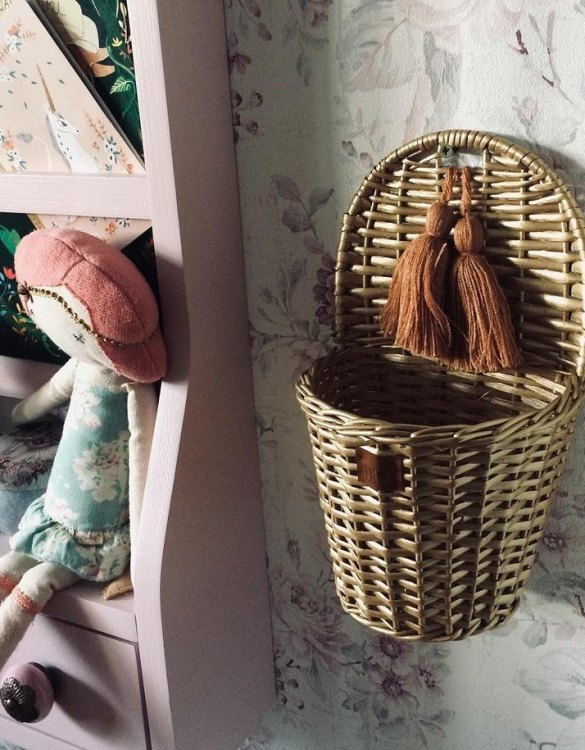 Made from the best quality polish wicker, the Old Gold Lu Wicker Wall Basket is a wonderful decoration for kids' rooms. This adorable wall hanging wicker basket is one of the most delightful storage options we have seen.