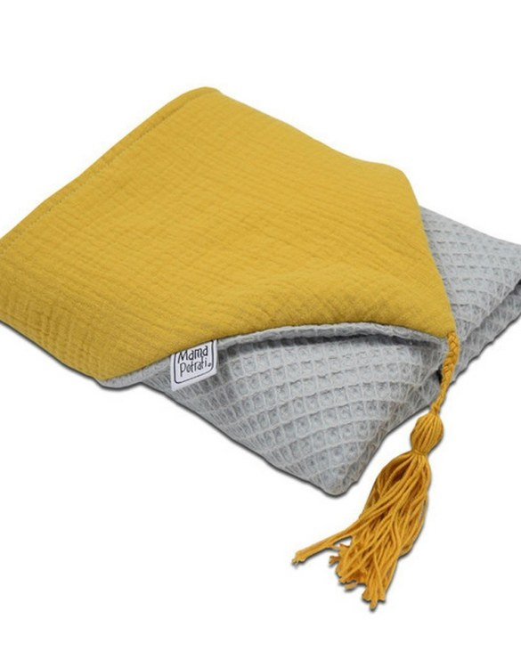Great for gifting, the Hooded Towel Gray & Mustard is made from a beautiful 100% cotton terrycloth to make an absorbent yet lightweight fabric. A soft infant hooded towel with a charming muslin hood.