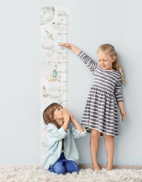 A real eye-catcher in every child's room, the Cosmic Child Growth Chart is the perfect way to follow your child's development and growth. Bright and colourful, this height chart wall sticker will look good in nurseries, bedrooms, or playrooms.