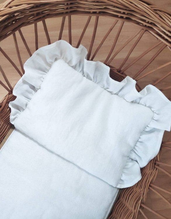 Perfect as a newborn pillow, the White Baby Pillow With Ruffle is a great addition for a nursery, children's room, baby crib, or kid's playroom. It makes the perfect gift!