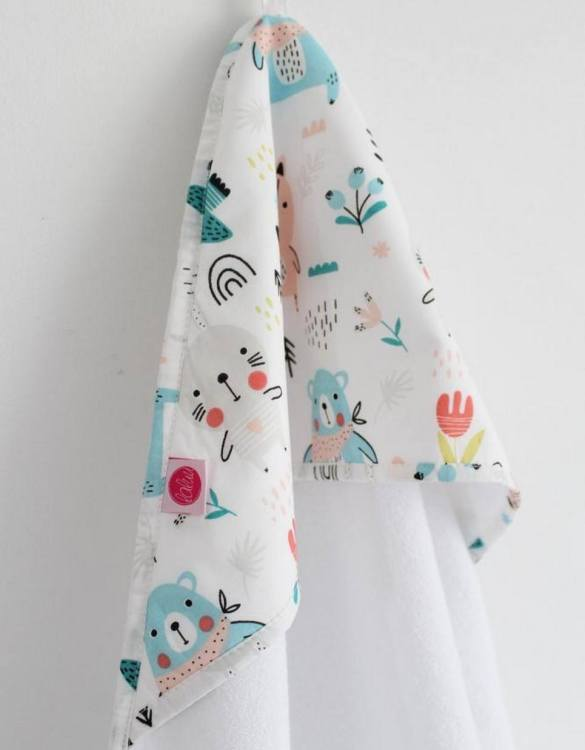 Keep your or a friend's little one warm and dry with the Teddy Bears Girl Baby Bath Towel. This hooded baby towel super soft and perfect for wrapping up your little one after a bath.