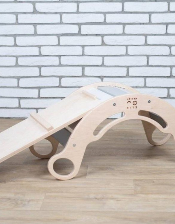 A great choice for playtime, the Natur Gray Rainbow Montessori Balance Board and Plank will quickly become your household's most beloved toy as well. This rocking toy will stimulate your toddler's senses, awaken their imagination, strengthen muscles and will promote the development of balance.