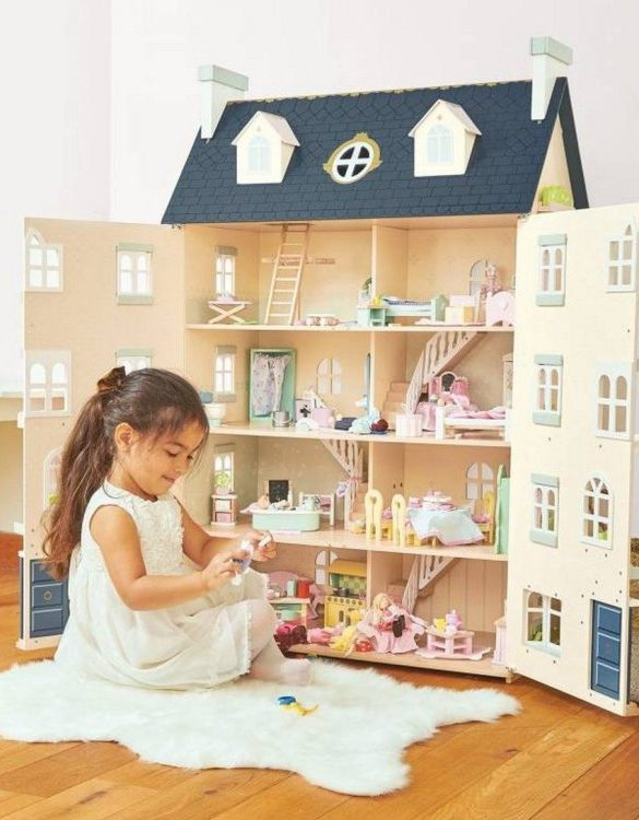Perfect for imaginative play. the Palace Wooden Dolls House comes with a beautiful set of furniture and accessories making playtime even more fun. A beautiful and design scandi dolls house in a wooden design will delight the heart of every little girl.