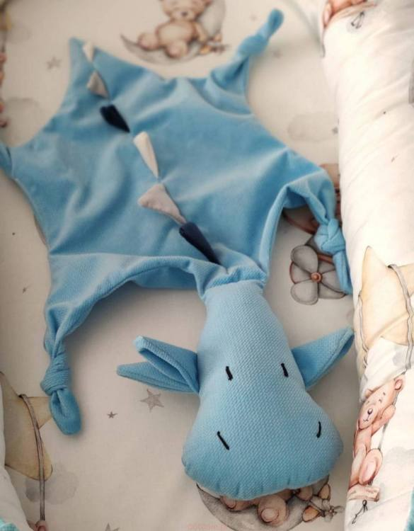 A cuddly toy designed mainly for babies, the Blue Dragon Doudou Baby Comforter is soft, cuddly, breathable, and perfect for little hands to hold. It is perfect to snuggle with in their stroller or crib, and as the little ones grow up, it will continue to be by their side.