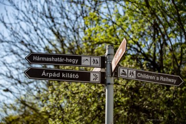 """A road sign pointing to various hikes and walk in the area. One of them says""""Arpad kilato"""", which is the lookout we were aiming for."""