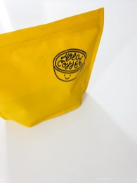 yellow bag of coffee beans.