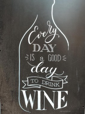 """A blackboard sign that says """"Every day is a good day to drink wine""""."""