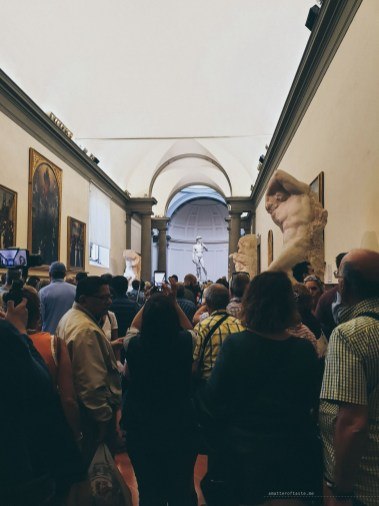 Life in Florence - crowded art gallery with David statue