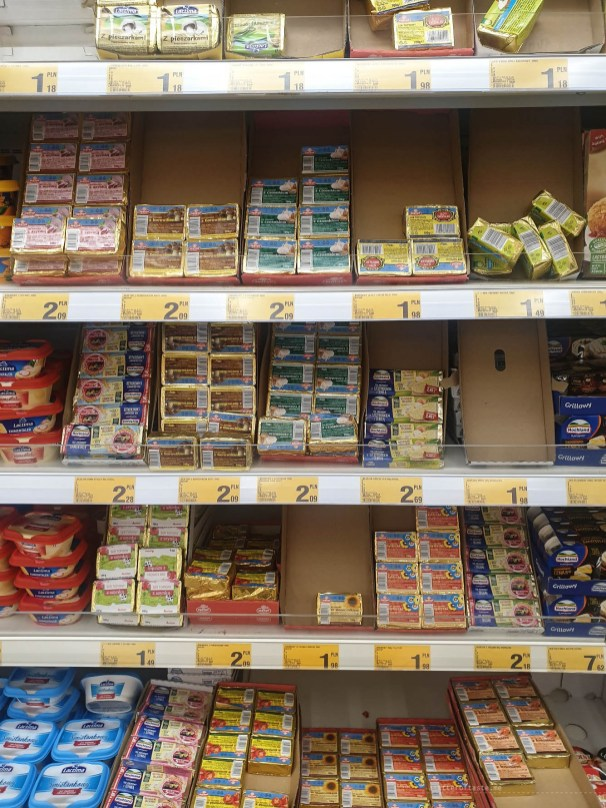 A section of supermarket alley filled with one of Polish classics - a spreadable processed cheese. They come in many flavours, like ham, onion or paprika.