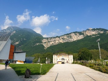 Museu museum of science in Trento with epic mountains in the background.