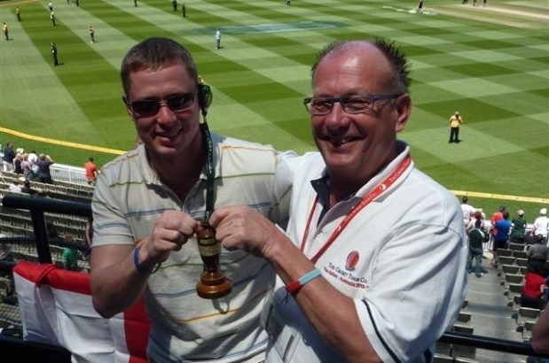 Holding the Ashes trophy
