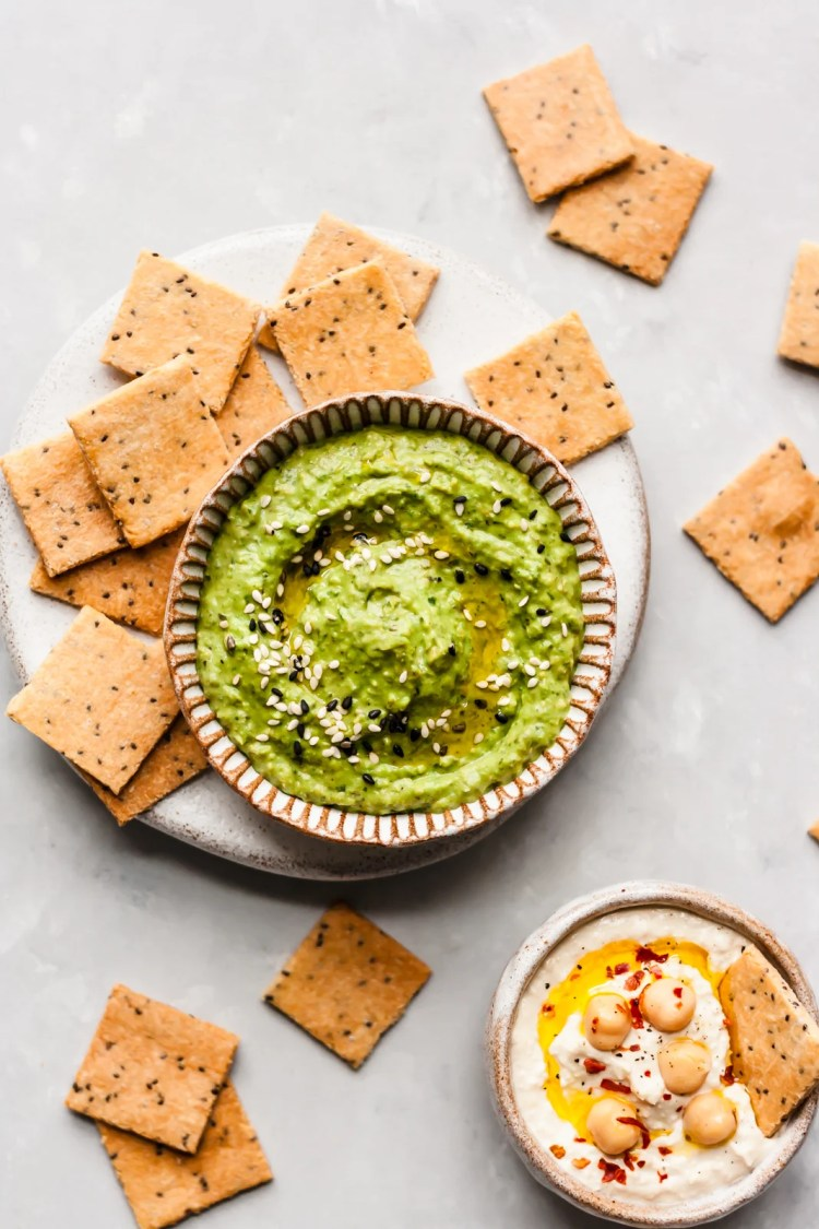 homemade paleo crackers on a plate with dip