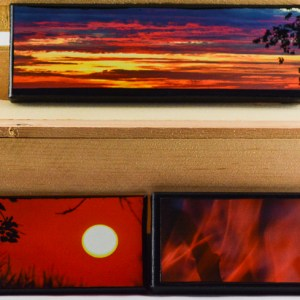 Three 3x9 inch artisan canvas prints. The top is Fall Sunrise III, captured in the Fall of 2017. Bottom row, left is Fall Sunset V, captured also in the Fall of 2017. Bottom row, right is Fire IV, captured in the late Summer of 2017. All canvases made in the Fall of 2018.