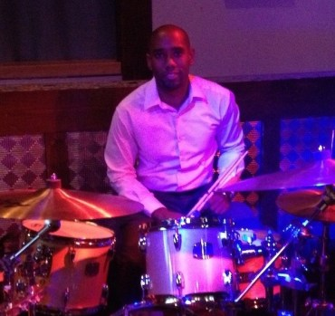 Ambus behind a set of drums on his 27th birthday.