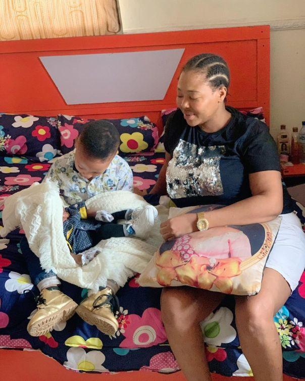 Omowunmi Ajiboye Son Obadara Cradling Newborn Obafemi Derek (2)