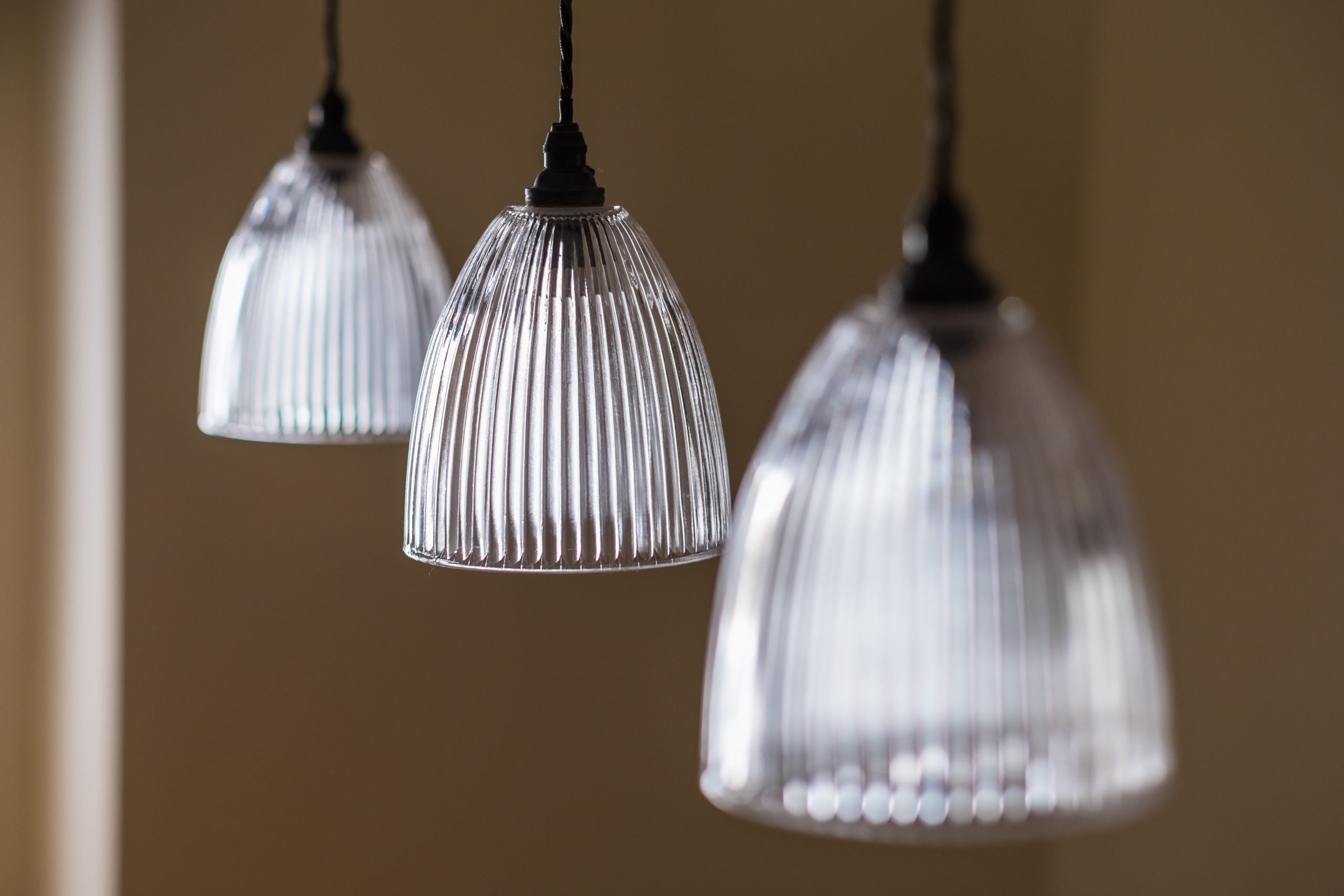 Vintage ribbed glass pendant lights from Fritz Fryer