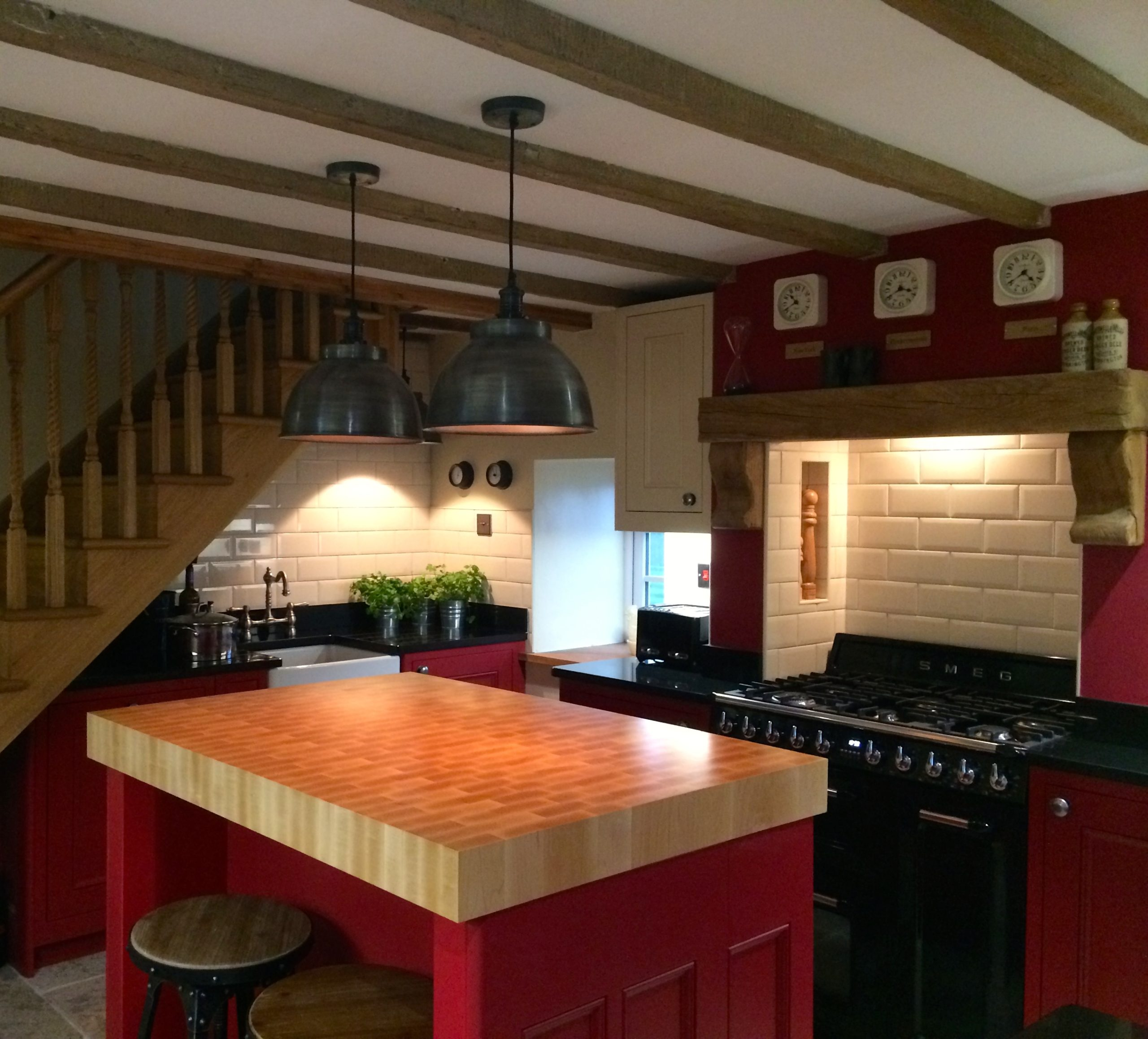 Striking inframe shaker kitchen in Farrow & Ball Rectory Red and Ringwold Ground by Amelia Wilson Interiors Interior Designer