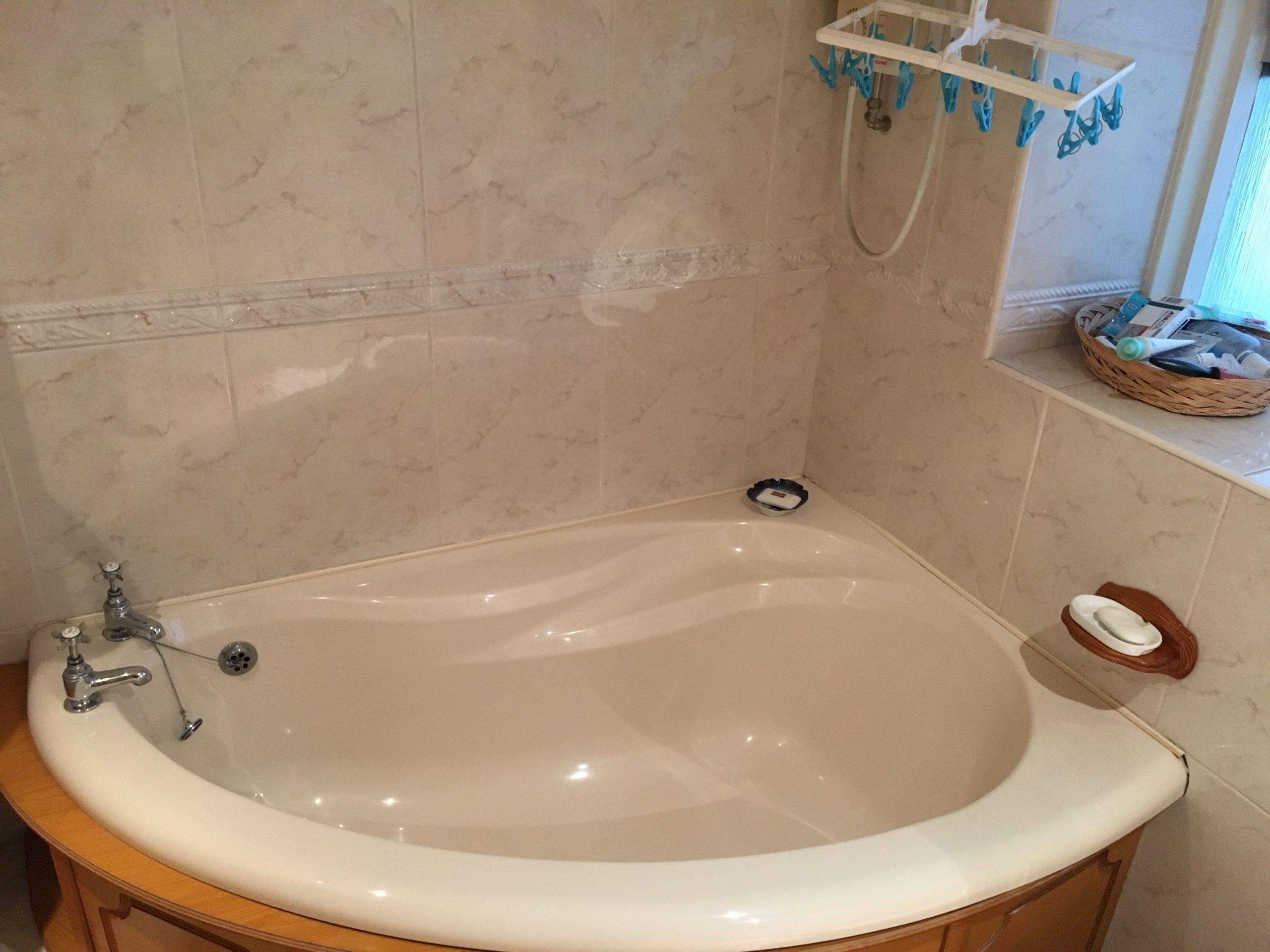 Dream bathroom - peach corner bath in before image