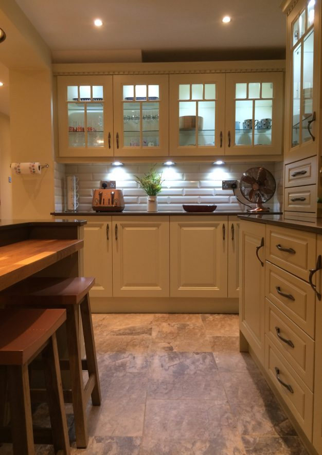 Cream shaker style kitchen with in cupboard lighting