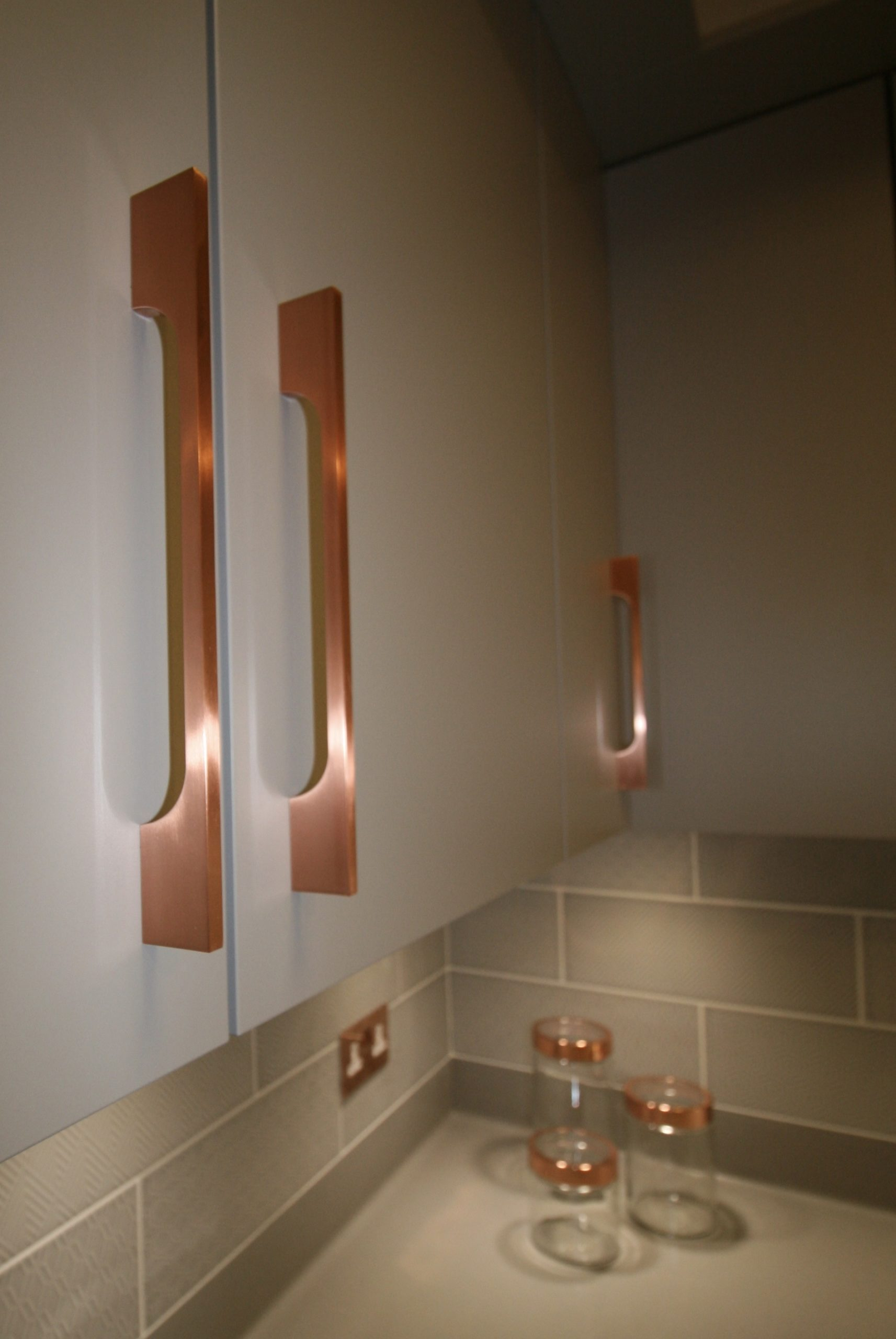 Polished copper kitchen cupboard and drawer handles