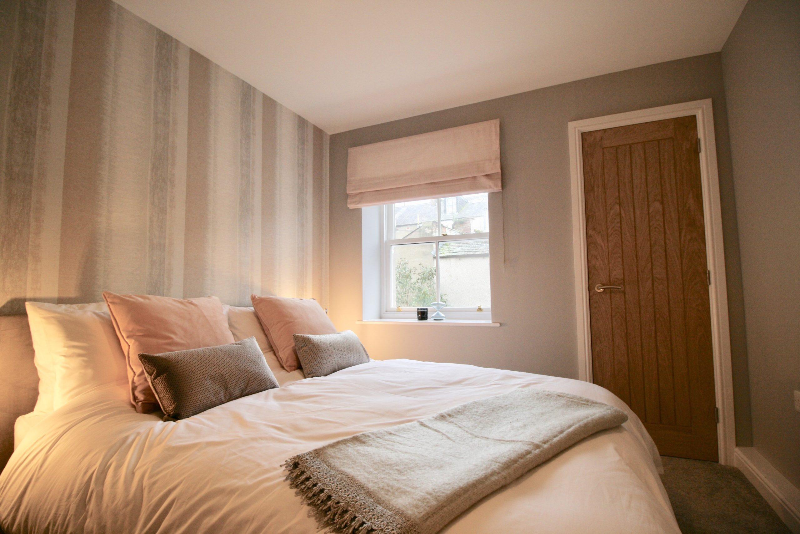 DuJour velvet blush roman blind from Blinds2Go for show home designed by Amelia Wilson Interiors Ltd