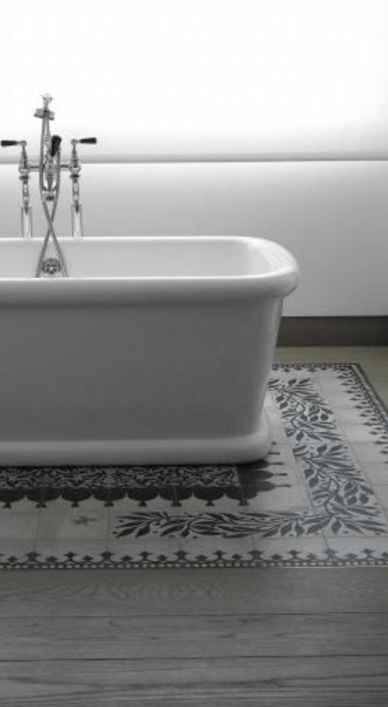 Bathrooms - Tiling used to create a rug effect under a bath