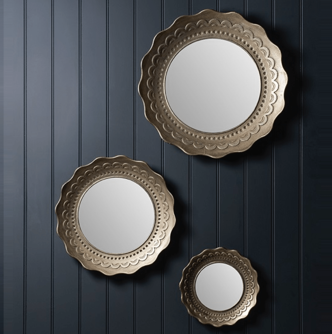 Set of three decorative gold mirrors